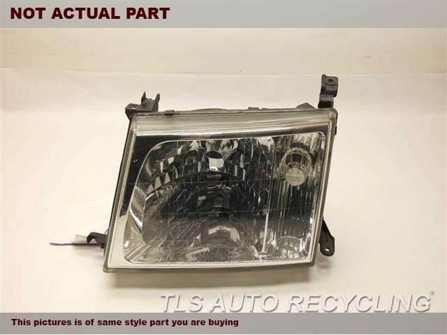 2004 Toyota Land Cruiser Headlamp Assembly. UPPER DAMAGE TAB DAMAGE DRIVER SIDE HEADLAMP 81050-6007